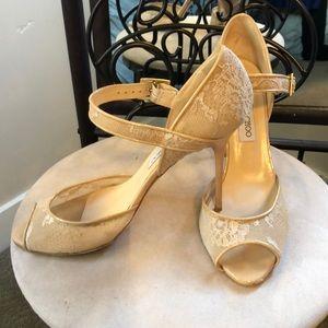 Jimmy Choo- creamy beige lace peep toe stiletto.
